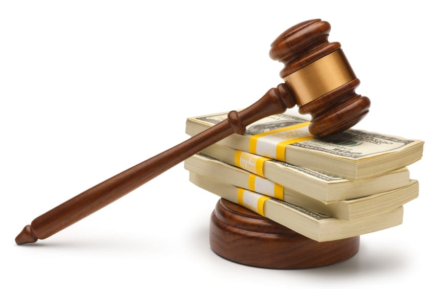 Wooden Gavel Laying On Top Of A Stack Of Money Stock Photo