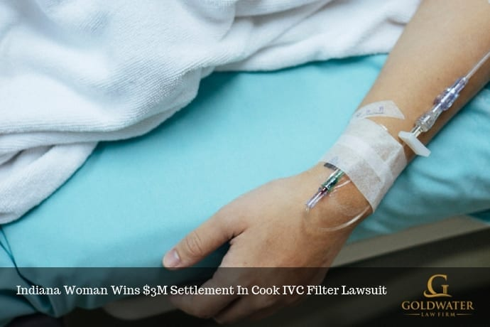 Woman In Pain In A Hospital Bed Stock Photo
