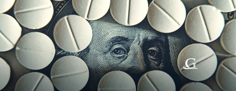 Prescription Pills On $100 Dollar Bill Stock Photo