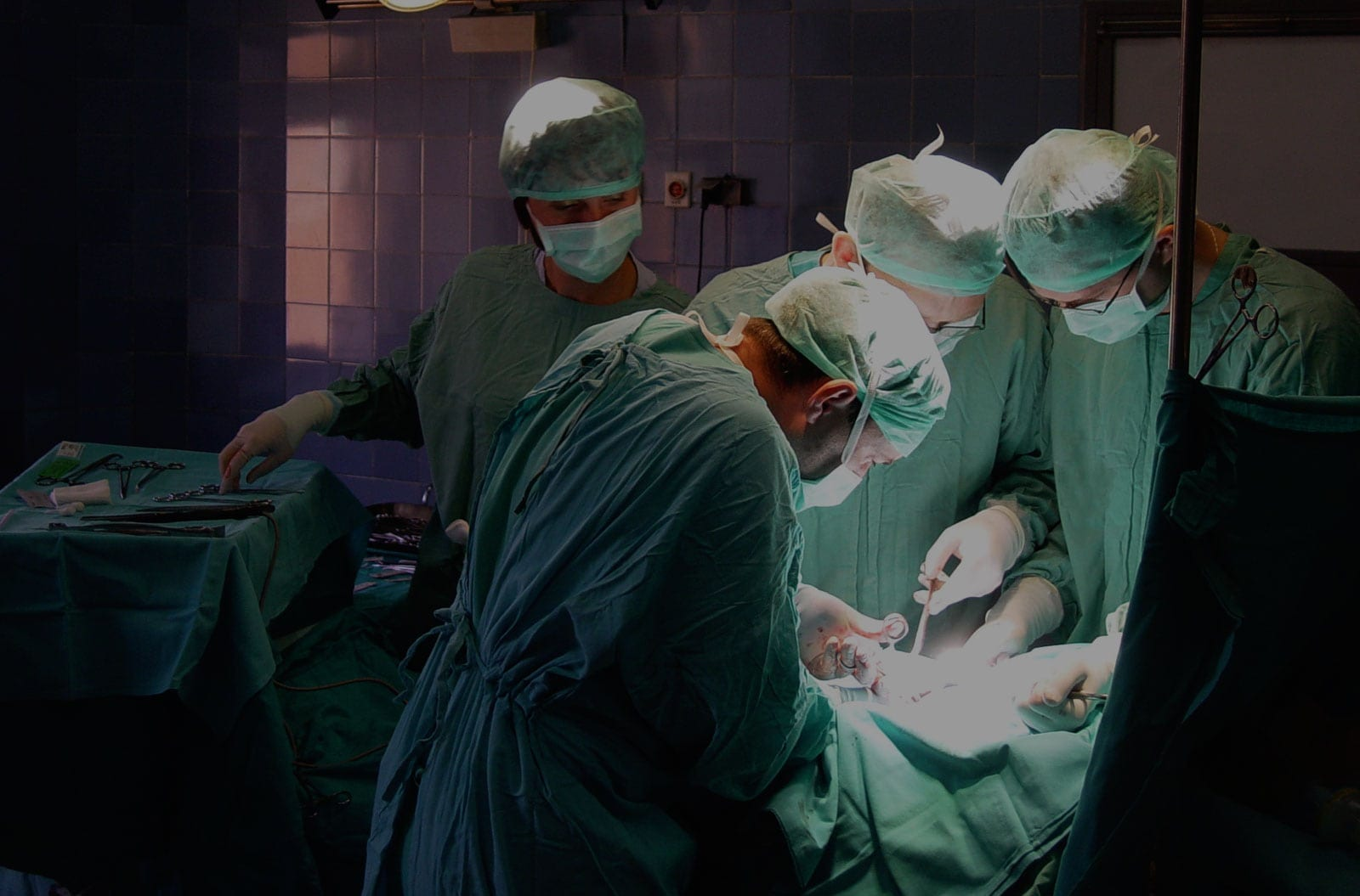Multiple Doctors Performing Surgery Stock Photo