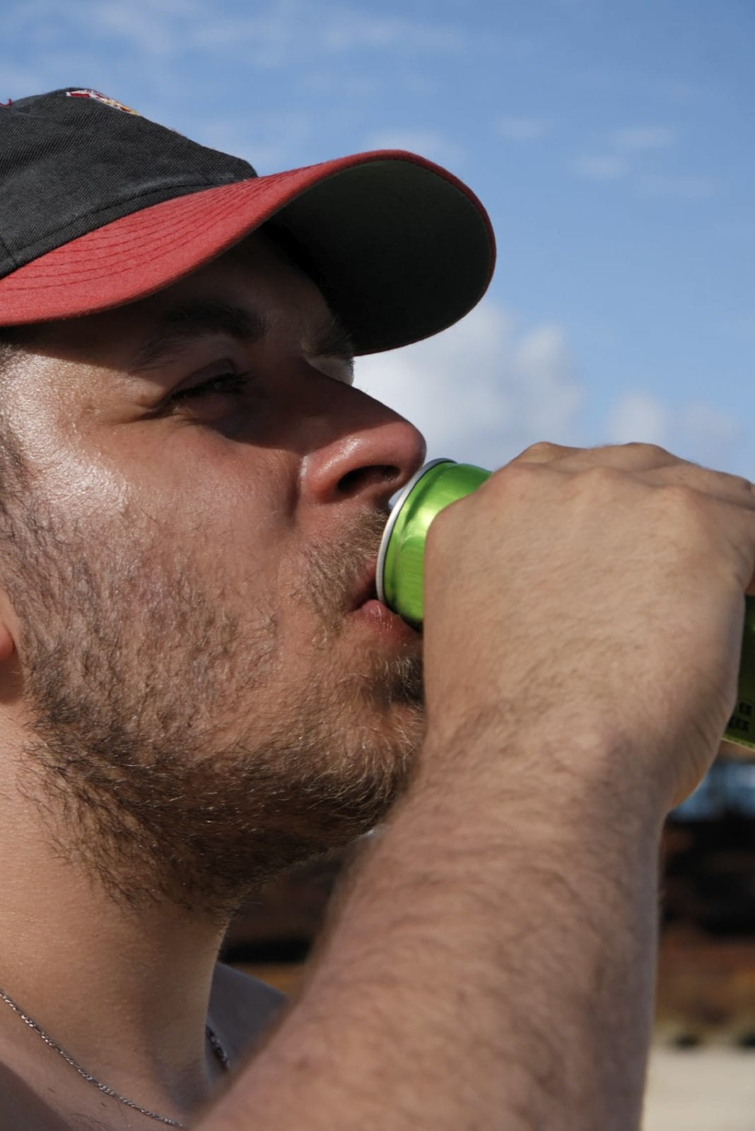 Young Man Drinking An Energy Drink Stock Photo