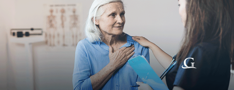 Elderly Woman Being Consoled By Nurse Stock Photo