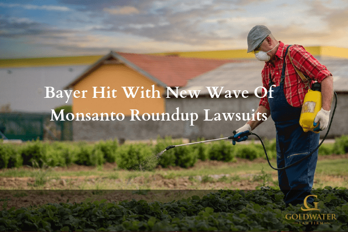 Man Using Monsanto Roundup Stock Photo