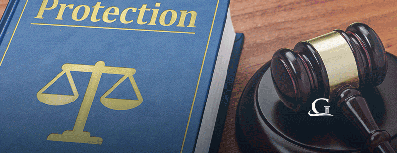 Protection Law Book With Gavel Stock Photo