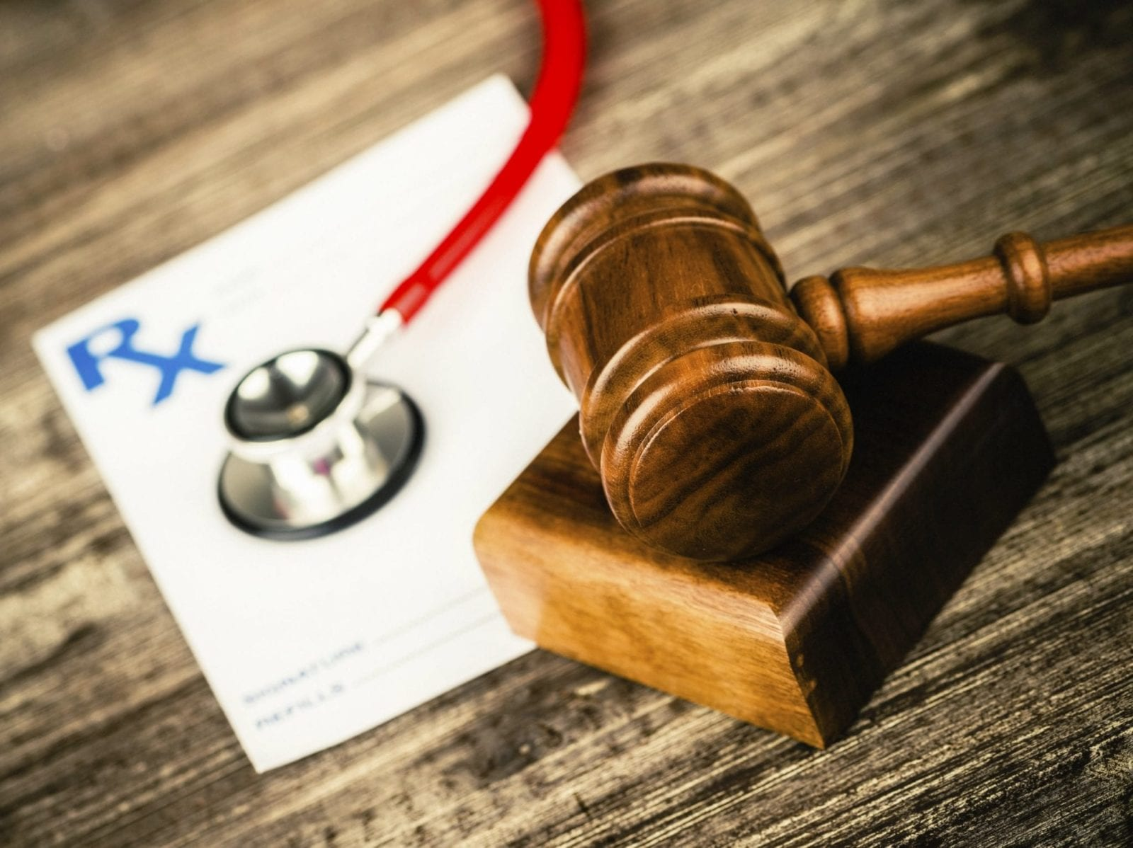 Stethoscope And A Gavel Stock Photo