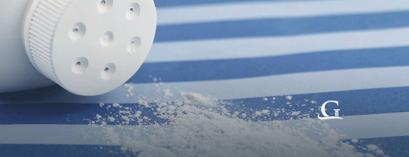 Spilled Talcum Powder Bottle Stock Photo