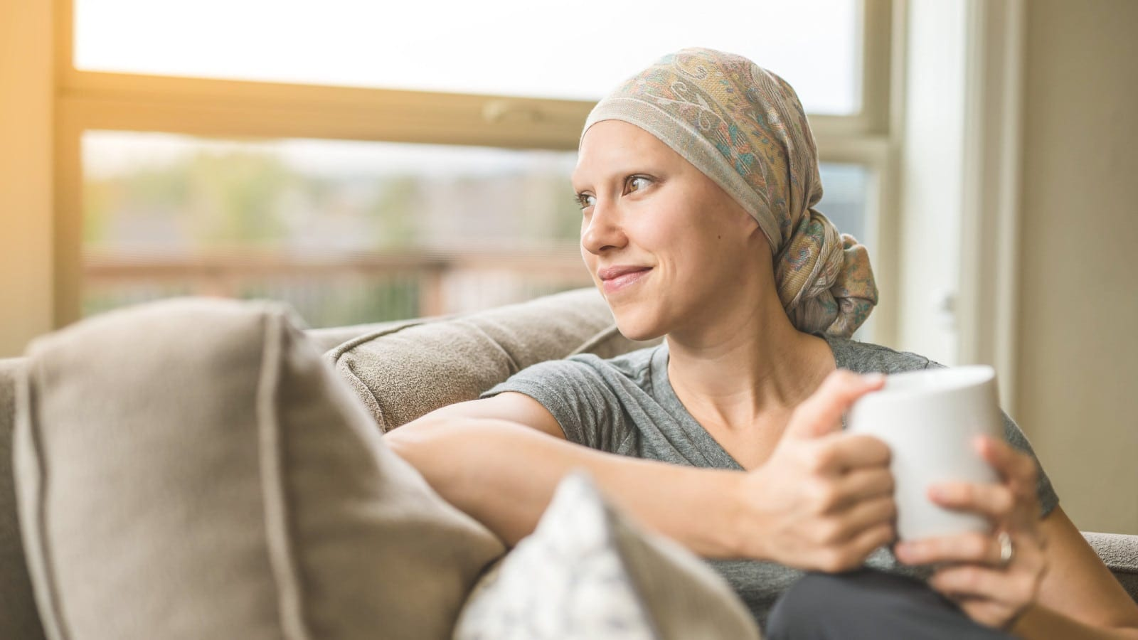 Woman with cancer sipping tea