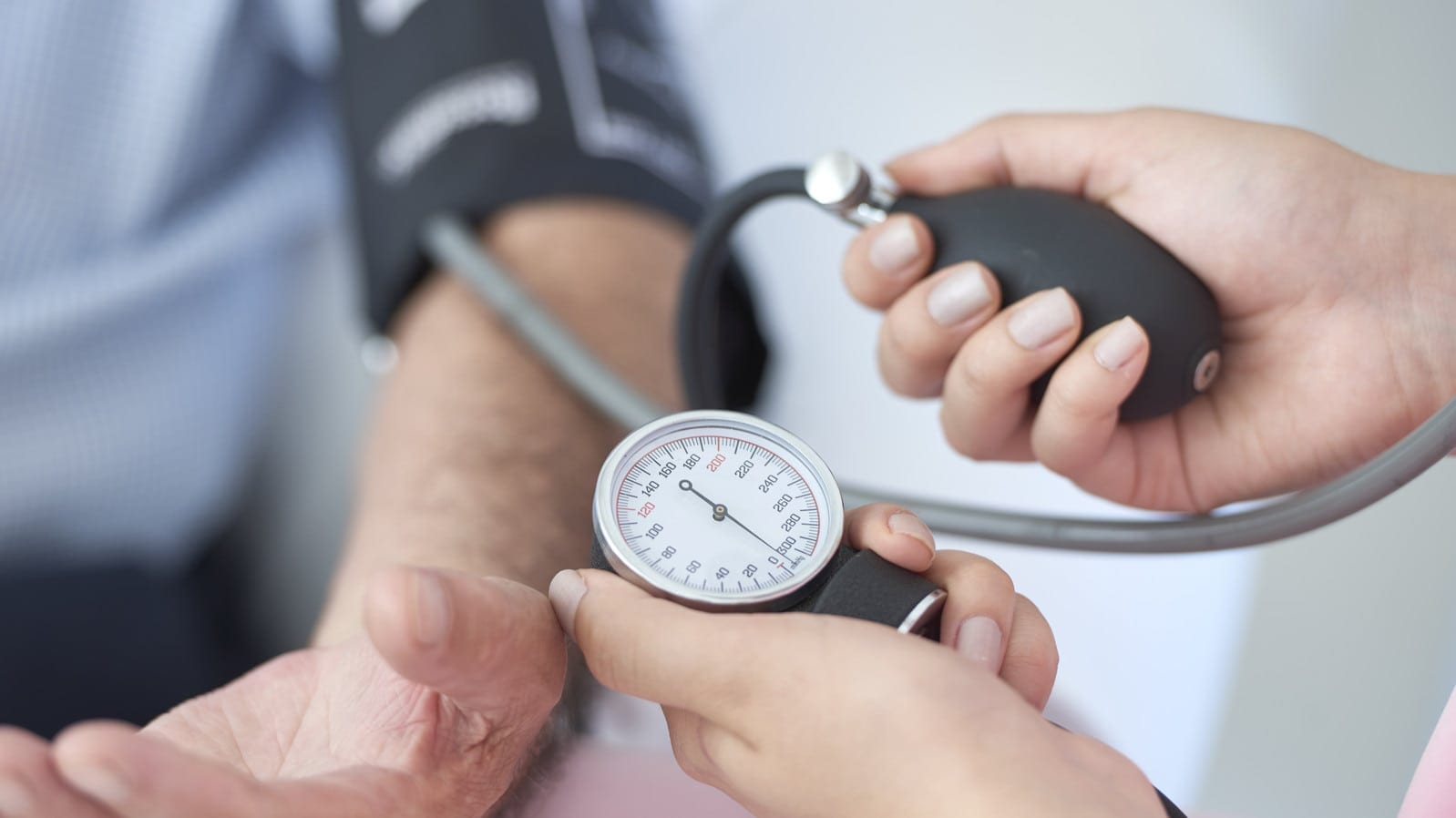 nursing taking blood pressure of xarelto patient