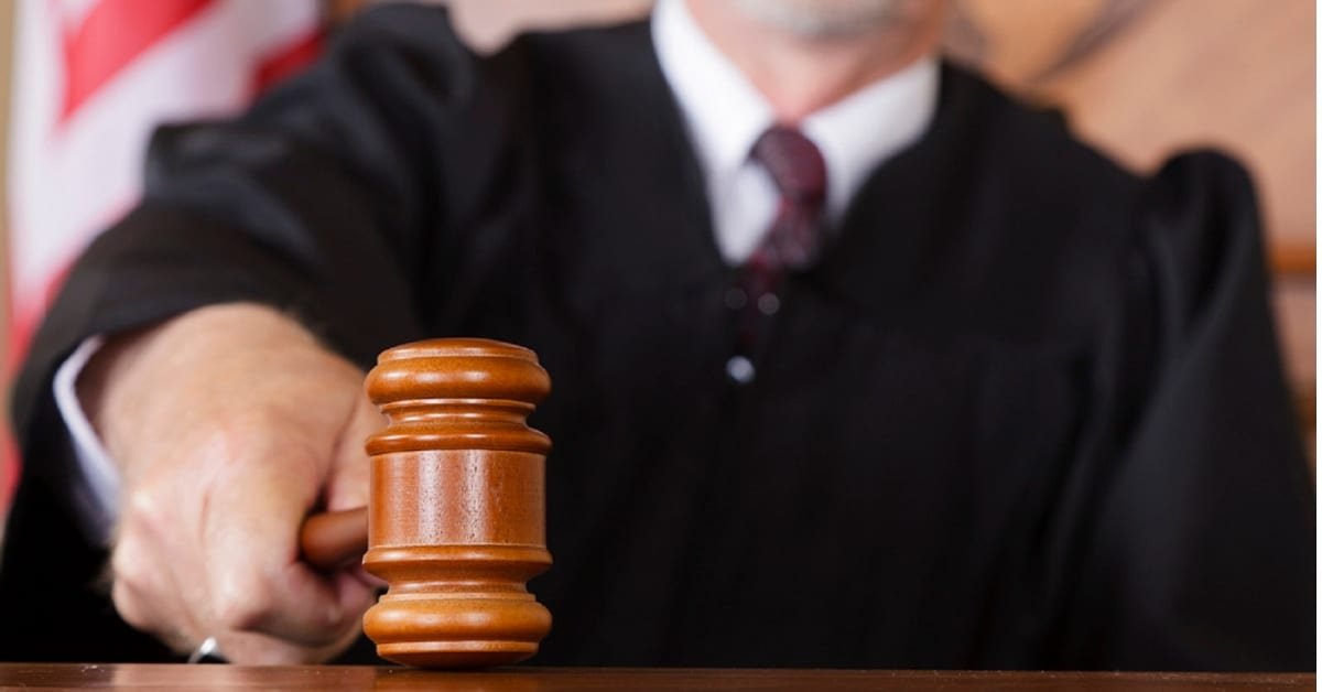 Judge Slamming A Gavel Stock Photo