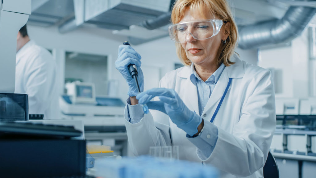 Research scientist working in pharmaceutical laboratory