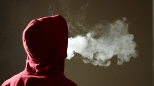 young-man-in-hoodie-vaping