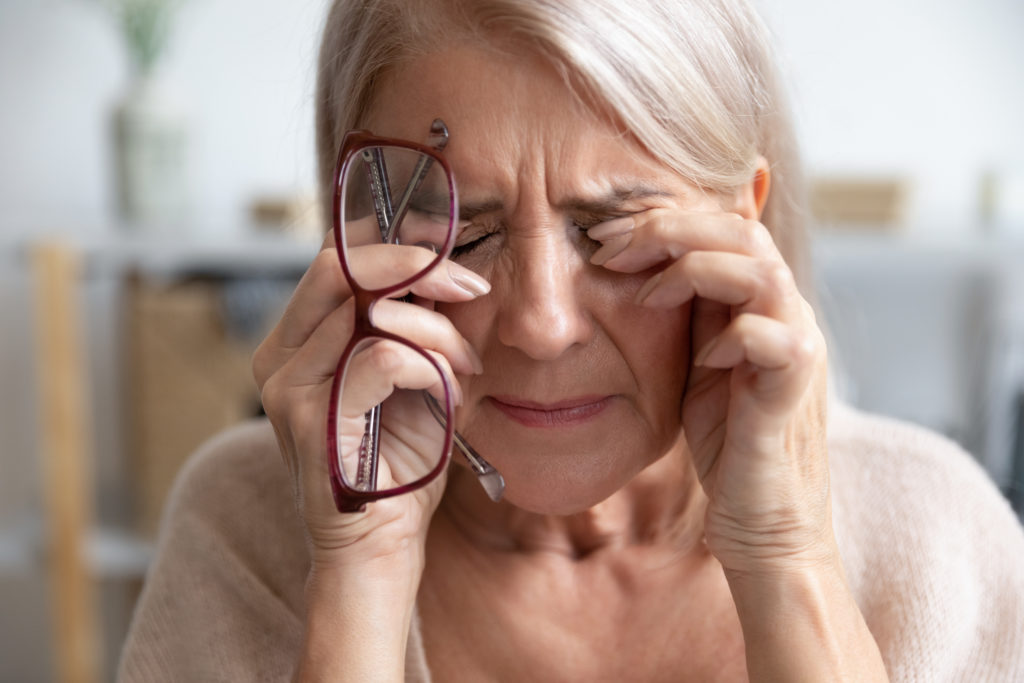Elder woman experiencing vision damage