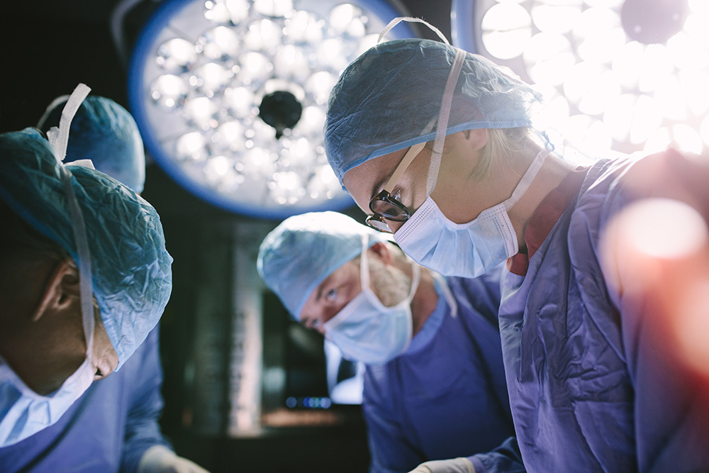 surgeons removing Paragard® IUD