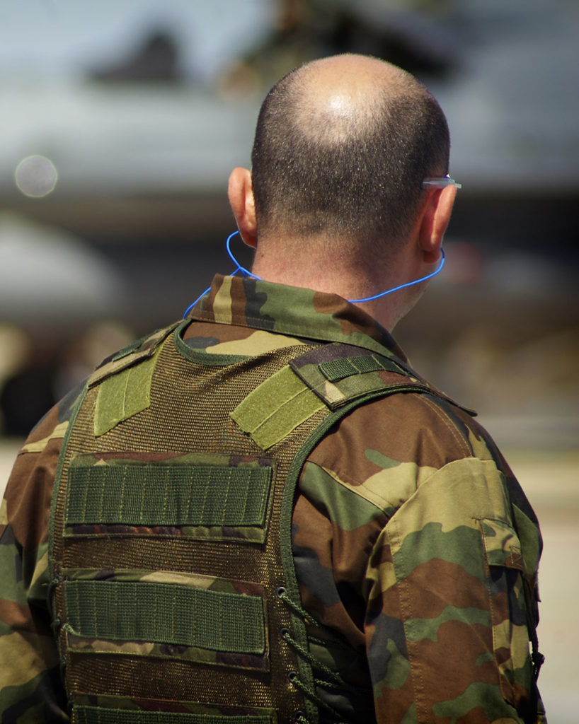 military members using earplugs to prevent hearing loss