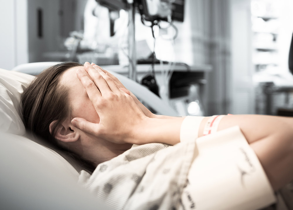 woman devastated after experiencing a birth injury