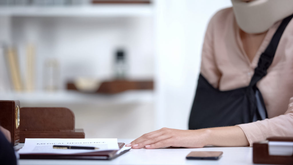 a woman hiring a personal injury lawyer after a Phoenix, AZ, accident