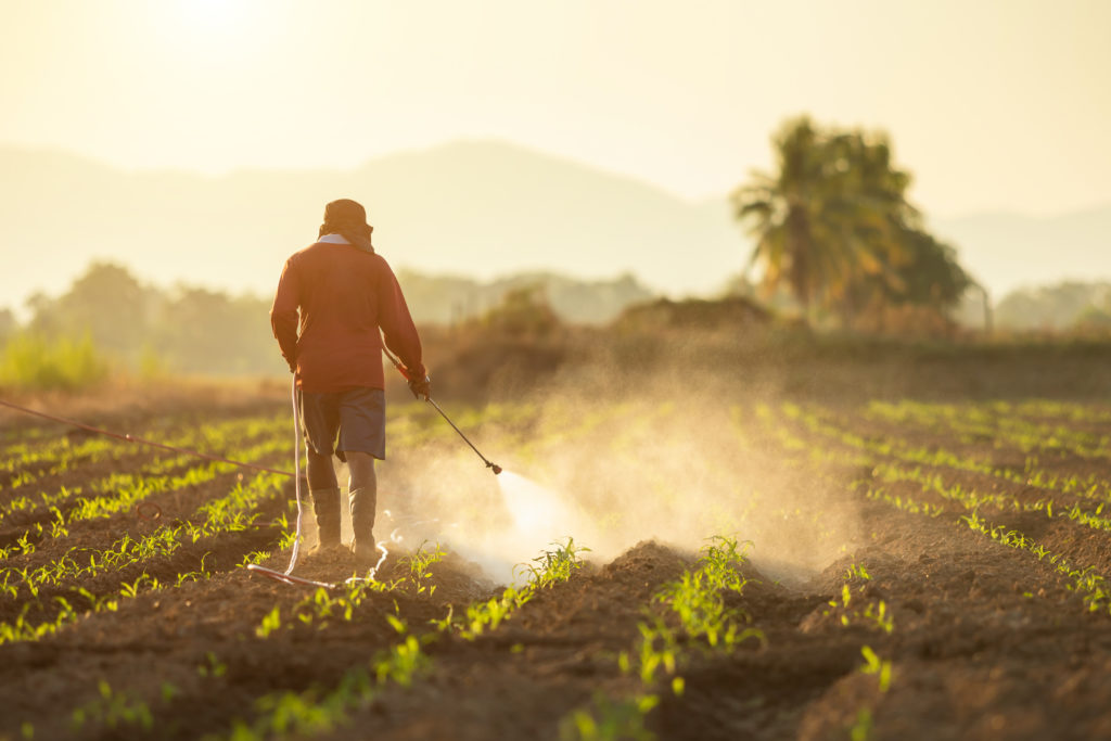 farmer spraying Roundup® weed killer on his crops